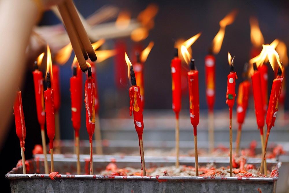 Chinese man burning incense and praying to a prosperous future, Guan Di Chinese Taoist Temple, Kuala Lumpur, Malaysia, Southeast Asia, Asia