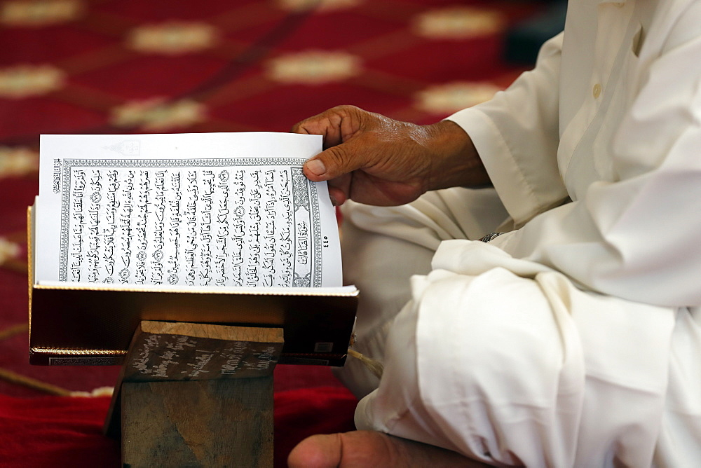 Muslim man reading an Arabic Holy Quran (Koran), Masjid Ar-Rohmah Mosque, Chau Doc, Vietnam, Indochina, Southeast Asia, Asia