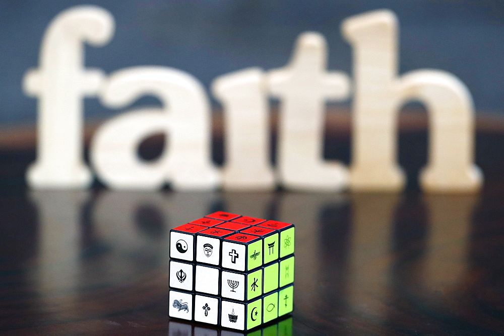 Wooden letters forming the word FAITH and Rubik's cube with religious symbols, Interreligious and interfaith dialog concept, Vietnam, Indochina, Southeast Asia, Asia