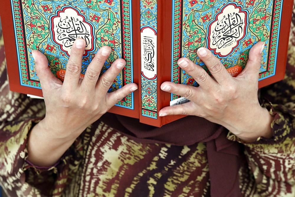 Muslim woman reading the Quran, The National Mosque (Masjid Negara), Kuala Lumpur, Malaysia, Southeast Asia, Asia