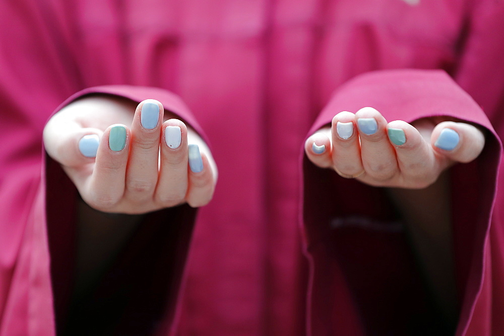 Close-up of hands of Muslim woman praying, Putra Mosque (Masjid Putra), Putrajaya, Malaysia, Southeast Asia, Asia