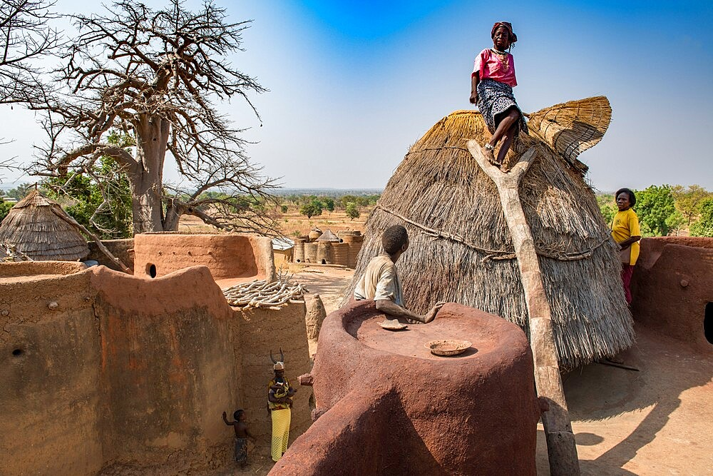 Old Batammariba woman standing in the granary on top of her takienta, the traditional earth tower house of Koutammakou region, La Kara, Togo, West Africa, Africa - 809-8162