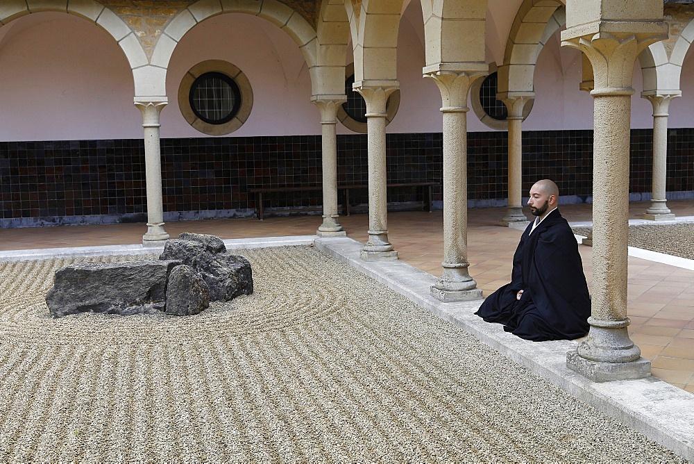 Zen Buddhist monk practising Zazen (meditation) in Orval Trappist Abbey's Zen garden, Belgium, Europe - 809-8172