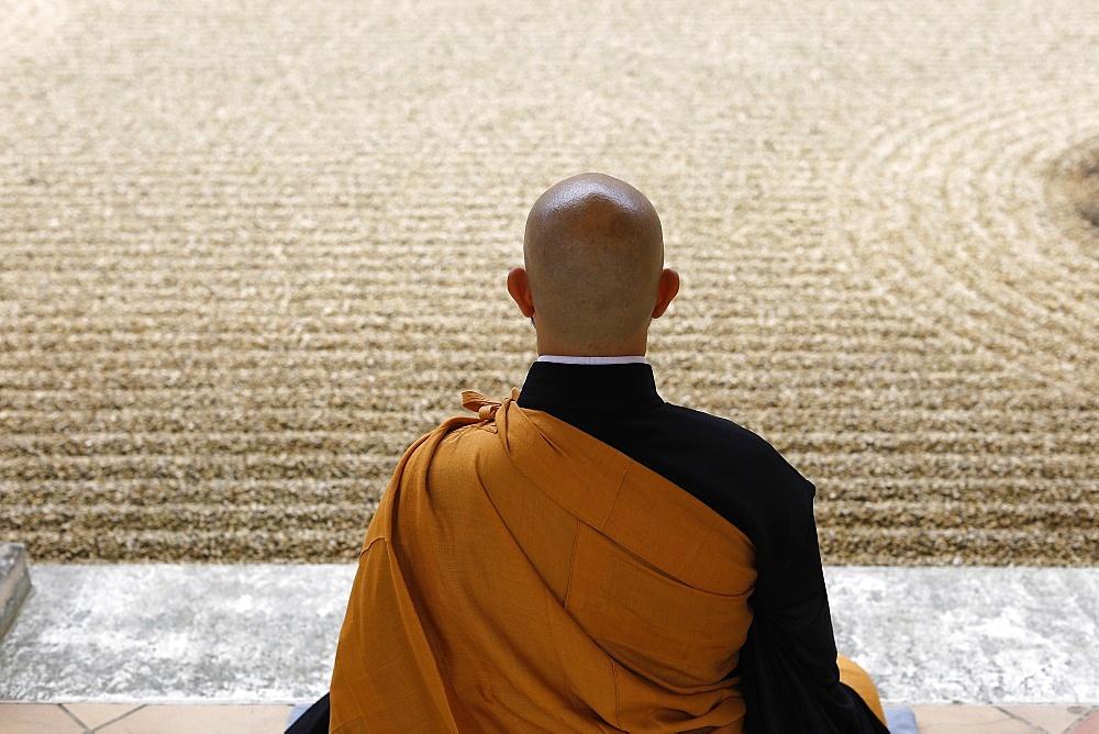 Zen Buddhist master practising Zazen (meditation) in Orval Trappist Abbey's Zen garden, Belgium, Europe - 809-8173