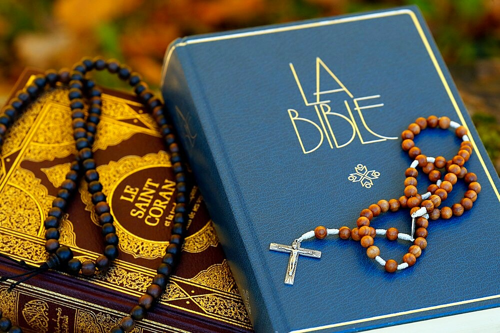 Holy Quran in French with Muslim prayer beads and Bible with rosary, Interfaith symbols between Christianity and Islam, France, Europe - 809-8179