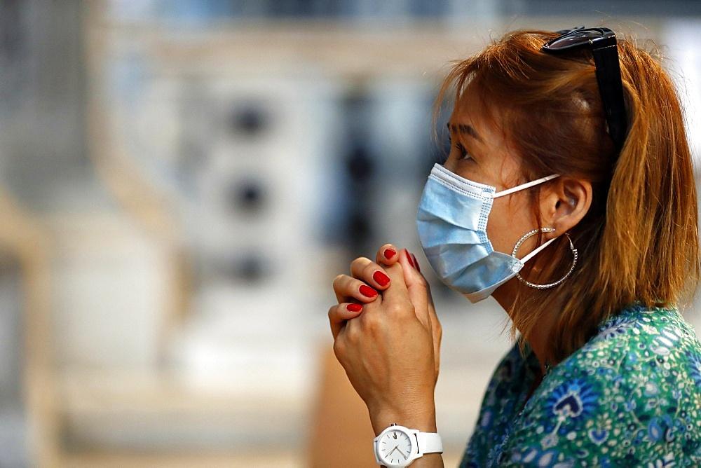 Woman with surgical mask praying in church during coronavirus epidemic (Covid-19), Venice, Veneto, Italy, Europe - 809-8185