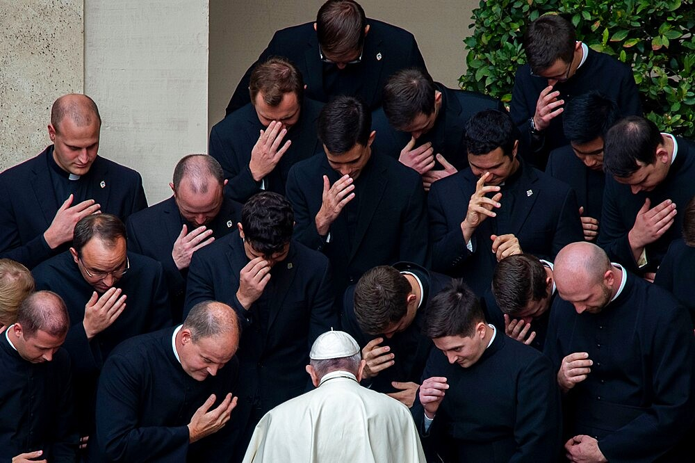 Pope Francis prays with priests at the end of a limited public audience at the San Damaso courtyard in The Vatican, Rome, Lazio, Italy, Europe - 809-8190