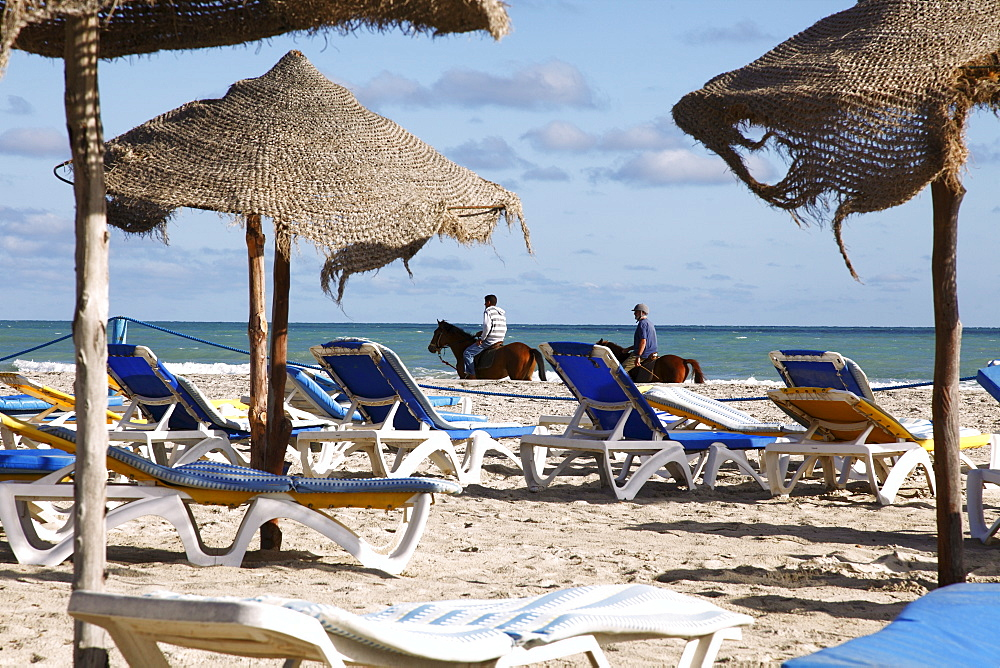 Beach scene on the Mediterranean coast in the tourist zone, Djerba Island, Tunisia, North Africa, Africa