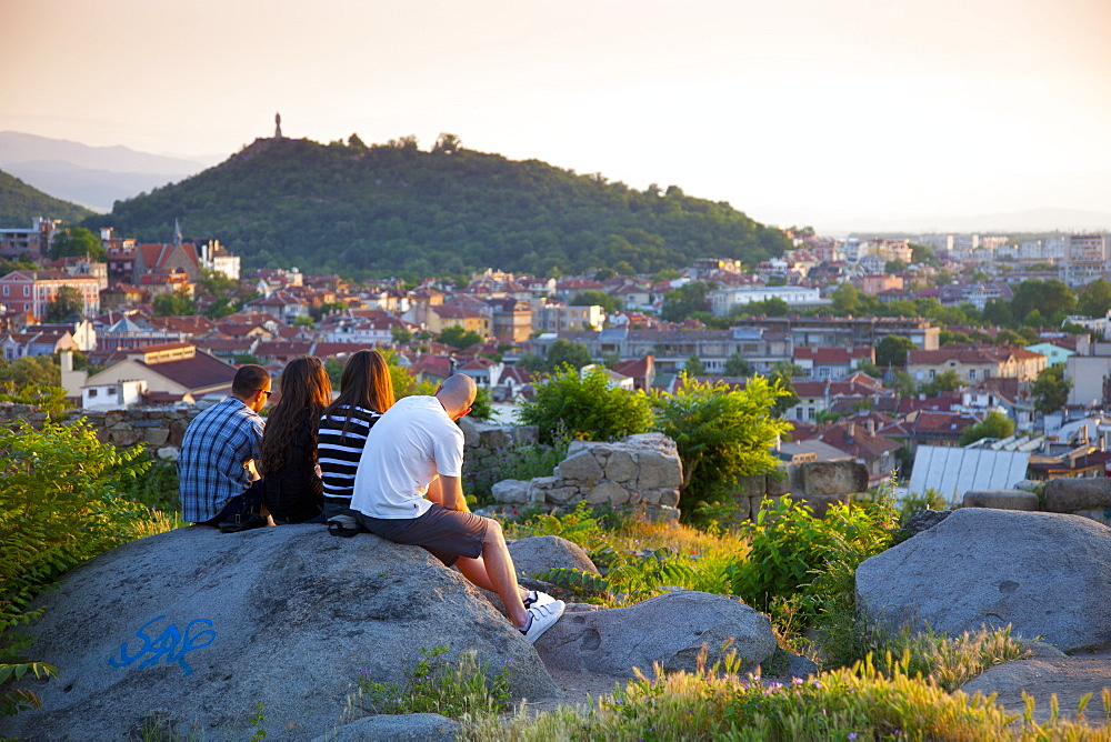 Sightseers viewing the Old Town at sunset from Nebet Tepe, Prayer Hill, the City's highest point, Plovdiv, Bulgaria, Europe - 813-260