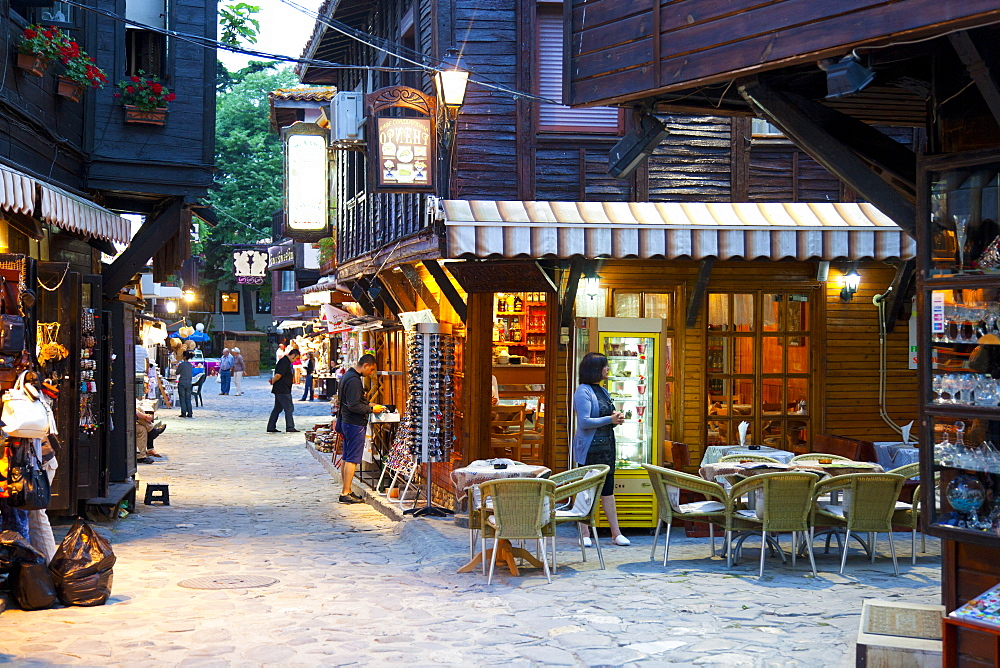 Souvenir shops and outdoor restaurants at dusk, Old Town, Nessebar, Bulgaria, Europe - 813-280