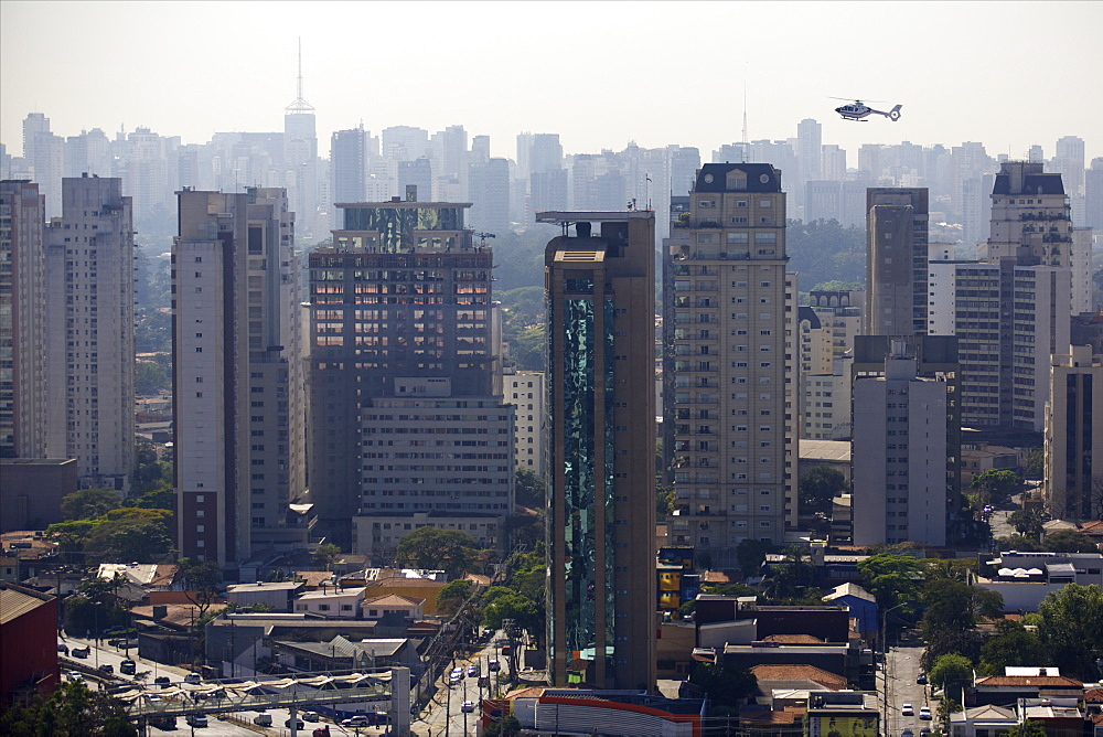 View over skyscrapers, traffic jam and helicopter in Sao Paulo, Brazil, South America - 814-1582