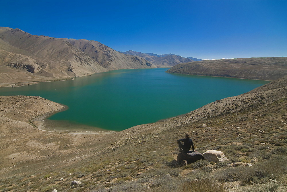 Tourist at the Yashil Kul lake, The Pamirs, Tajikistan, Central Asia