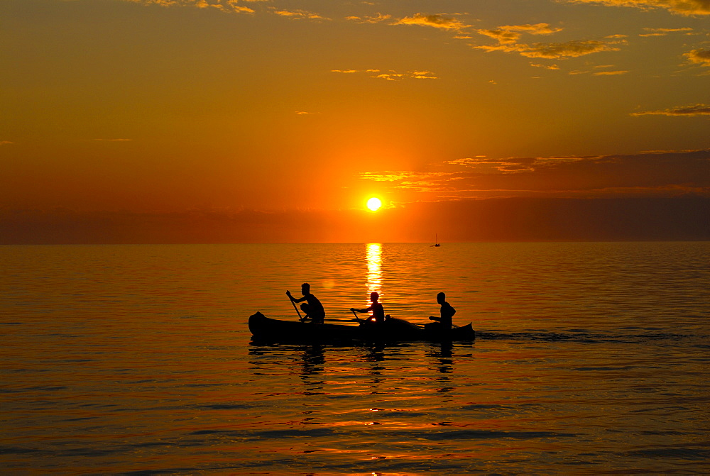 People rowing home at sunset at Ifaty, near Toliara, Madagascar, Indian Ocean, Africa