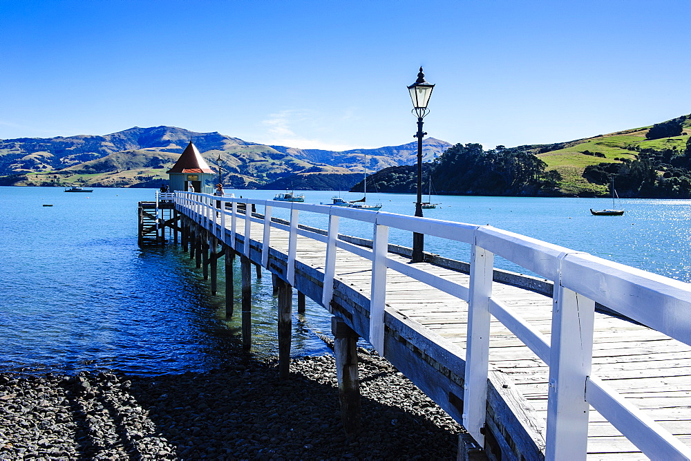 Long wooden pier in Akaroa, Banks Peninsula, Canterbury, South Island, New Zealand, Pacific