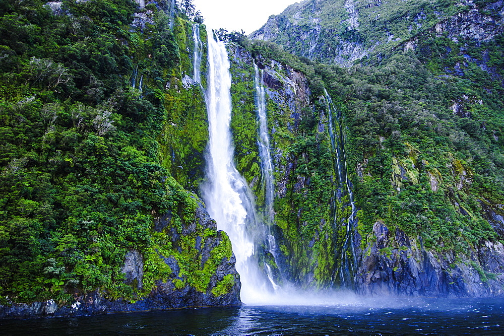 Huge waterfall in the Milford Sound, Fiordland National Park, UNESCO World Heritage Site, South Island, New Zealand, Pacific