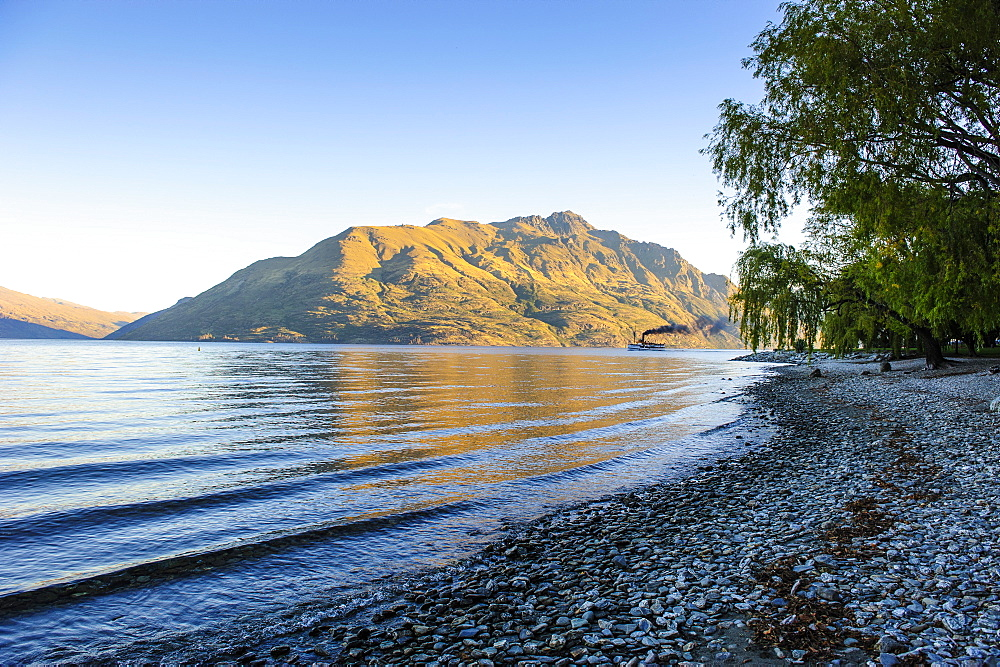 Late afternoon light over the shores of Lake Wakatipu, Queenstown, Otago, South Island, New Zealand, Pacific