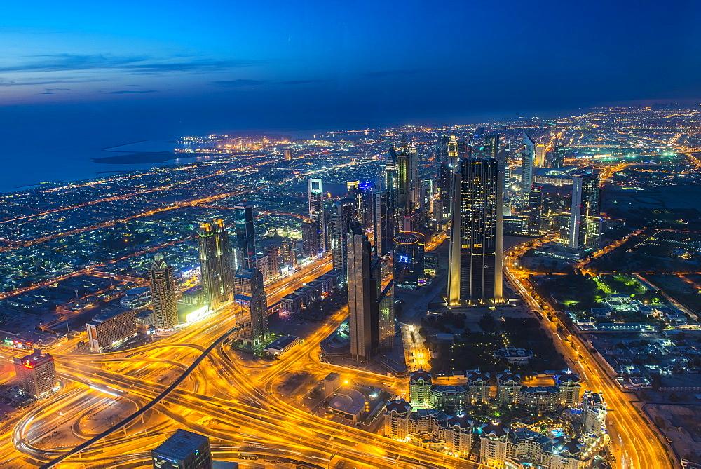 View over Dubai from Burj Khalifa at night, Dubai, United Arab Emirates, Middle East