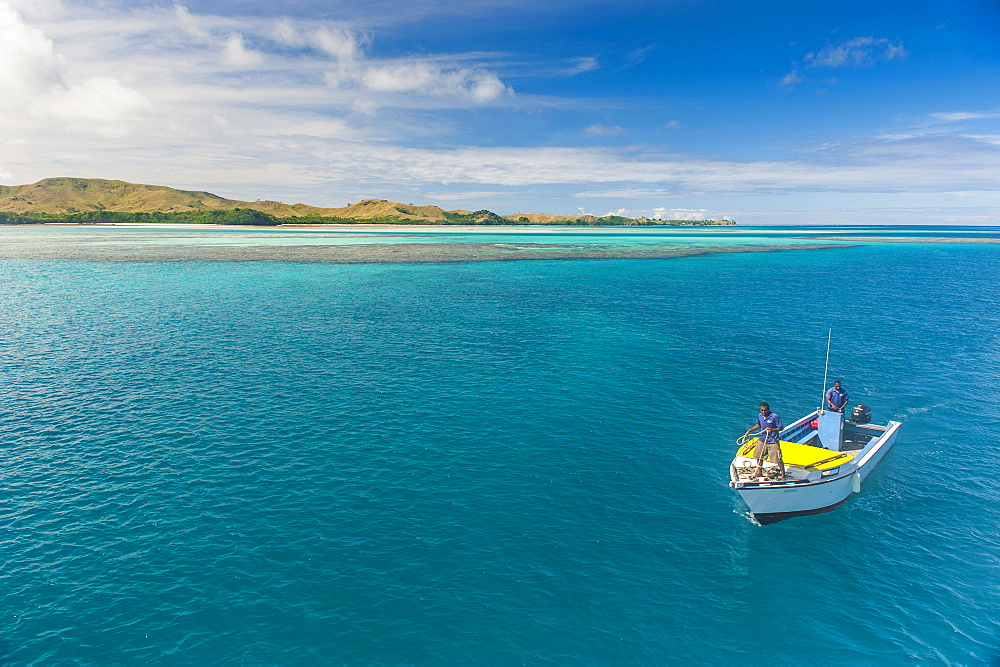 Little boat in the blue lagoon, Yasawas, Fiji, South Pacific, Pacific