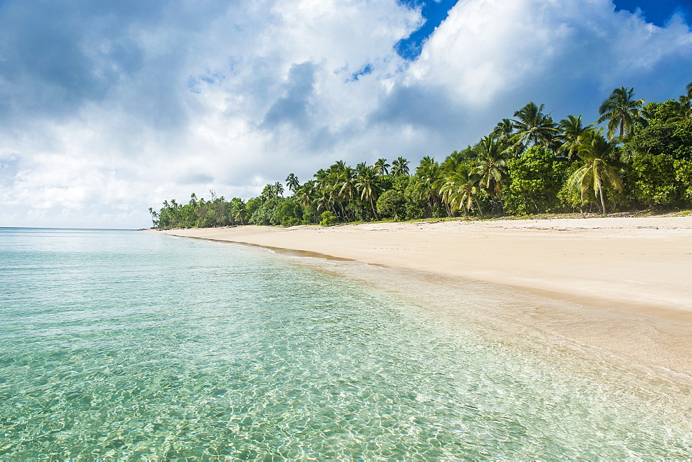 Palm fringed white sand beach in Haapai, Haapai Islands, Tonga, South Pacific, Pacific