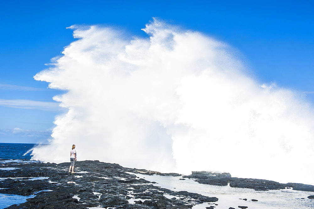 Tourist enjoying the huge waves in the Alofaaga blowholes on the south of Savaii, Samoa, South Pacific, Pacific