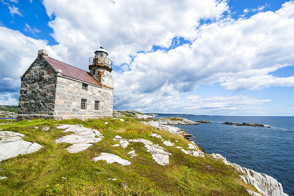 Stone lighthouse in Rose Blanche, remote village in southern Newfoundland, Canada, North America