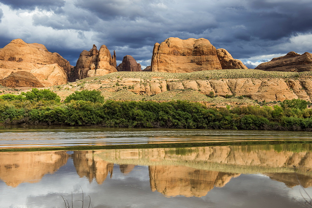 Sandstone rocks reflecting in the Colorado River, Canyonlands National Park, Utah, United States of America, North America