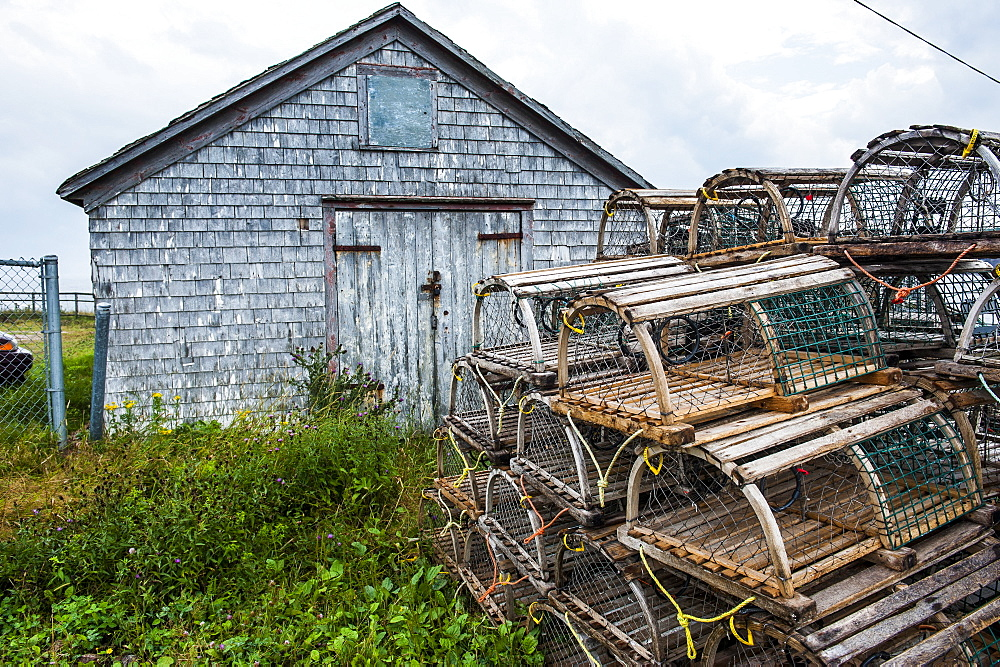 Fish traps in front of a shingle hut in Neils Harbour, Cape Breton Highlands National Park, Cape Breton Island, Nova Scotia, Canada, North America