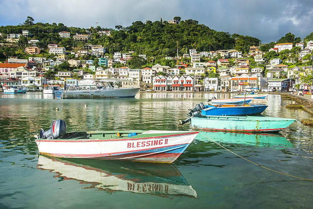 Little motoboat in the inner harbour of St. Georges, capital of Grenada, Windward Islands, West Indies, Caribbean, Central America
