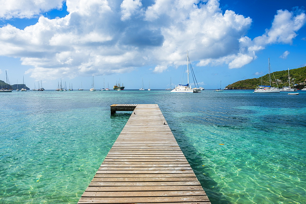 Boat pier in the turquoise waters of Admiralty Bay, Bequia, The Grenadines, St. Vincent and the Grenadines, Windward Islands, West Indies, Caribbean, Central America