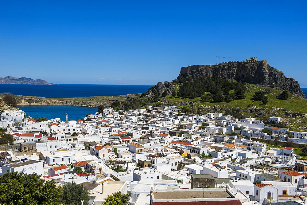 Panoramic view of beautiful Lindos village with its castle (Acropolis), Rhodes, Dodecanese Islands, Greek Islands, Greece, Europe