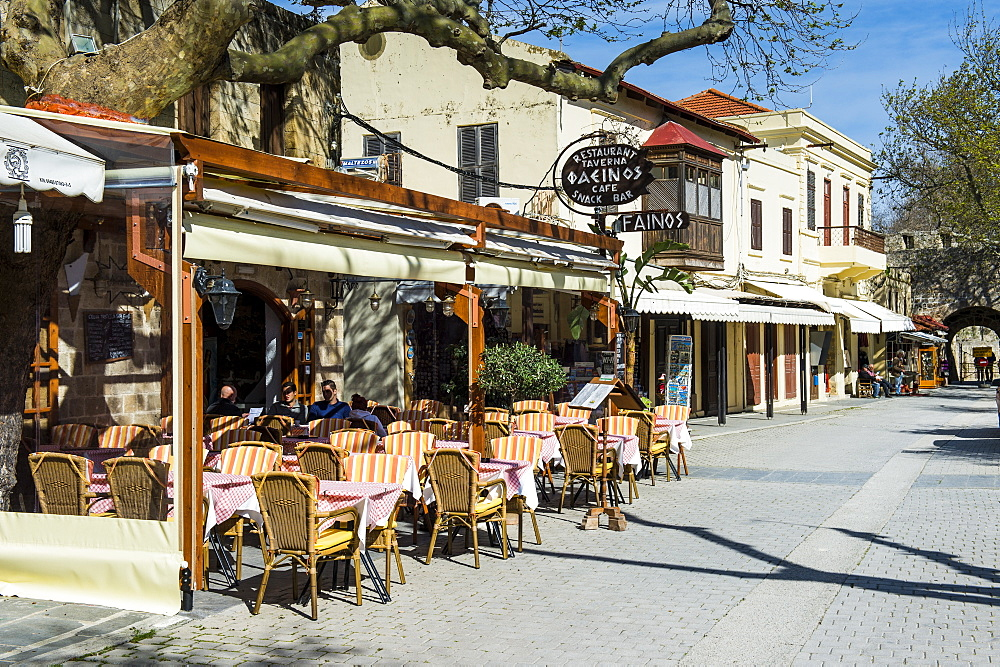 Street cafe in the Medieval Old Town, UNESCO World Heritage Site, City of Rhodes, Rhodes, Dodecanese Islands, Greek Islands, Greece, Europe