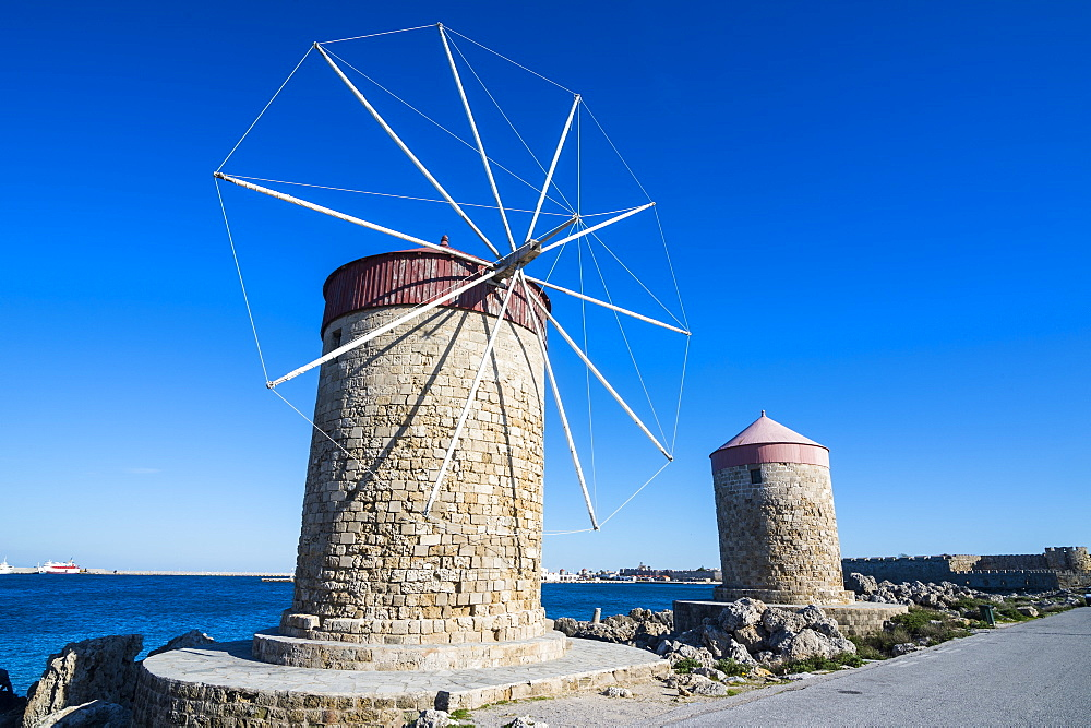 Medieval windmills at Mandraki harbour, City of Rhodes, Rhodes, Dodecanese Islands, Greek Islands, Greece, Europe