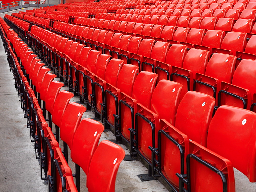 Rows of empty red stadium seats at Manchester United, Manchester, England, United Kingdom, Europe - 818-102