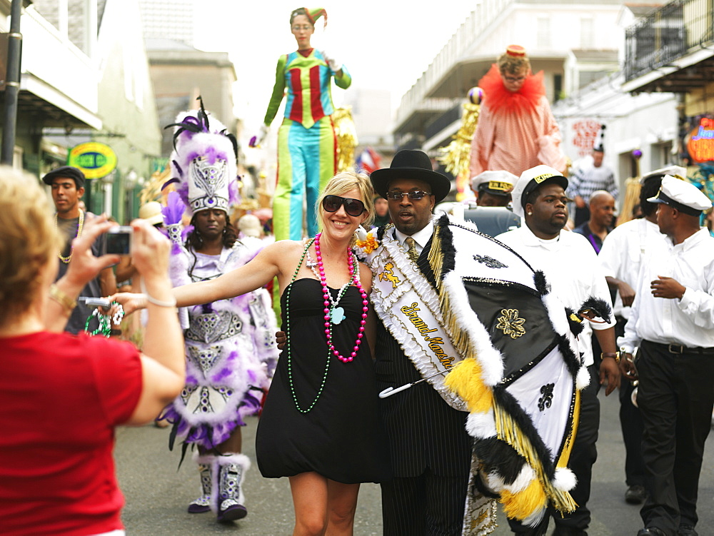 Tourist having photo taken with Grand Marshall of the parade, French Quarter, New Orleans, Louisiana, United States of American, North America - 818-454