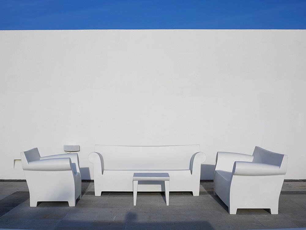 White chairs against a white wall and blue sky, Mayan Riviera, Akumal, Yucatan, Quintana Roo, Mexico, North America