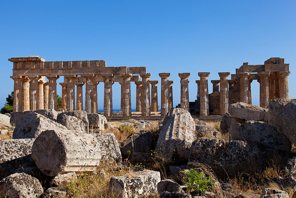 Temple of Athena ruins and Temple of Hera in the background at Selinunte, the ancient Greek city on the southern coast of Sicily, Italy, Europe