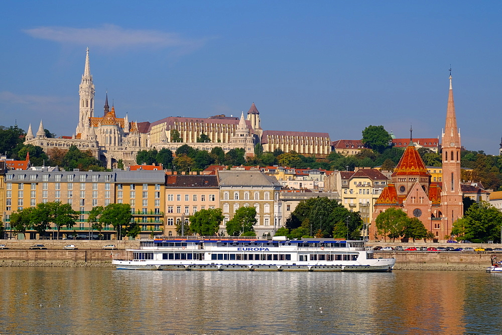 The Capuchin Church (Kapucinus Templom) and in the foreground the Matthias church and the Fishermen's bastion, Halaszbastya, Buda side of the River Danube, Budapest, Hungary, Europe