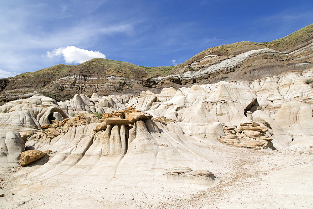 The hoodoos, rock formations formed by the erosion of Bentonite in the Badlands close to Drumheller in Alberta, Canada, North America - 826-672