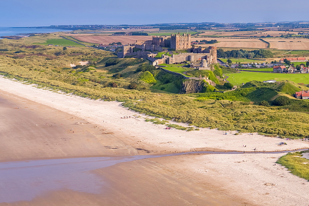 Aerial view by drone of Bamburgh Castle. Bamburgh, Northumberland, England, United Kingdom, Europe