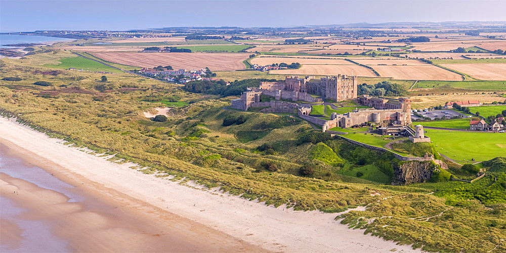 Aerial view by drone of Bamburgh Castle, Bamburgh, Northumberland, England, United Kingdom, Europe - 828-1211