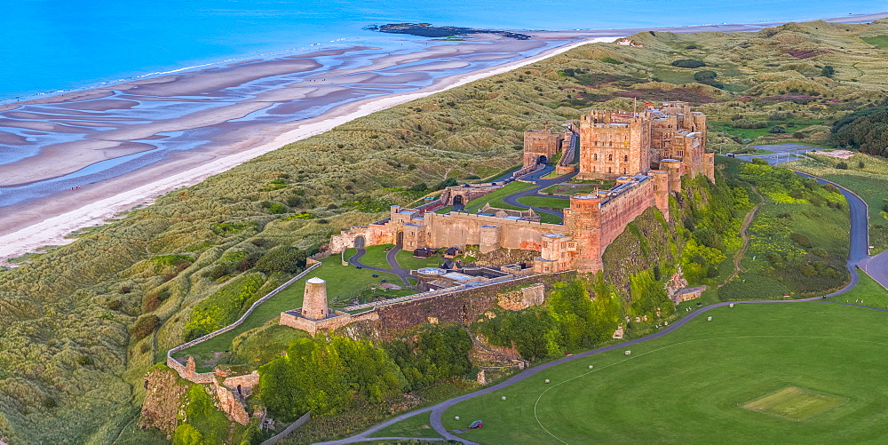 Aerial view by drone of Bamburgh Castle, Bamburgh, Northumberland, England, United Kingdom, Europe - 828-1215