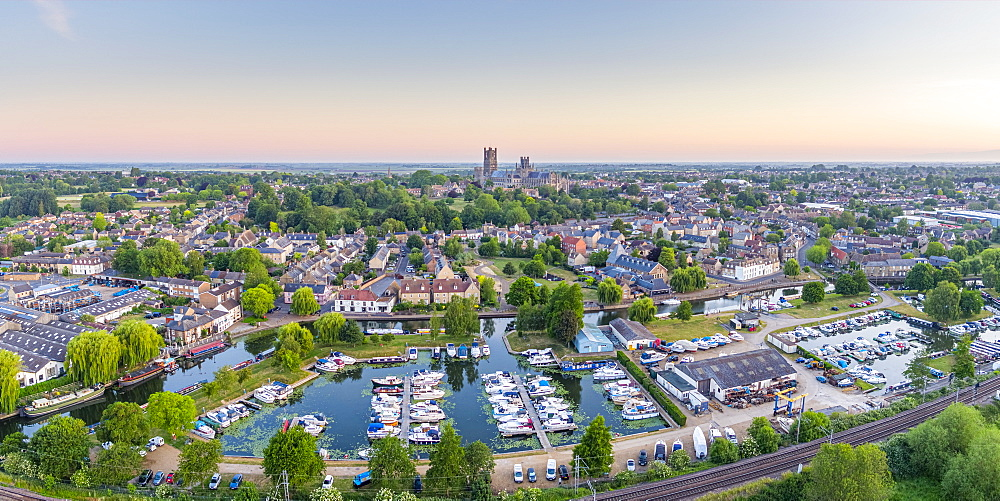 Drone view of Ely Cathedral with Ely Marina and Great Ouse River in foreground, Ely, Cambridgeshire, England, United Kingdom, Europe - 828-1445