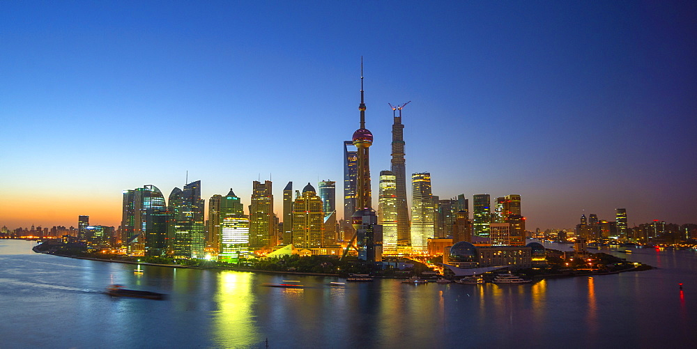 Financial District skyline including Oriental Pearl Tower and Shanghai Tower, Pudong District, Huangpu River, Shanghai, China, Asia