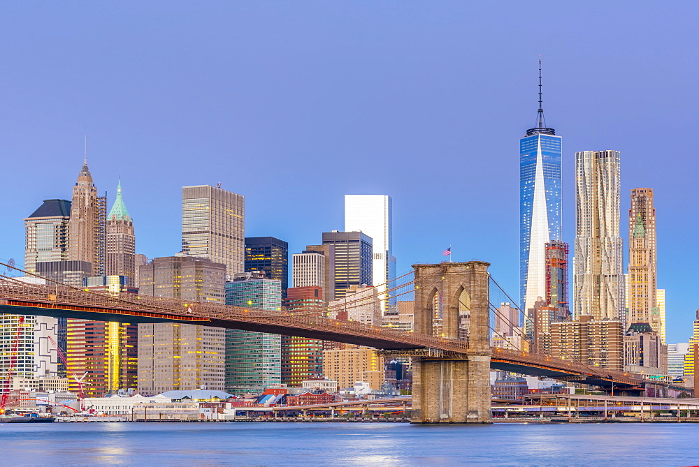 Manhattan skyline and Brooklyn Bridge across East River, New York, United States of America, North America