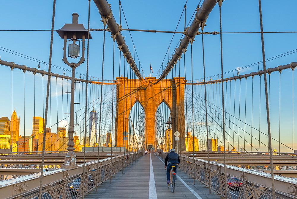 Manhattan, Brooklyn Bridge over East River, Lower Manhattan skyline, including Freedom Tower of World Trade Center, New York, United States of America, North America - 828-953