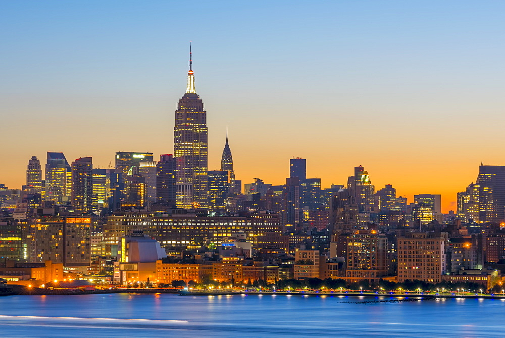 New York skyline with Midtown, Manhattan and Empire State Building viewed across Hudson River, New York, United States of America, North America