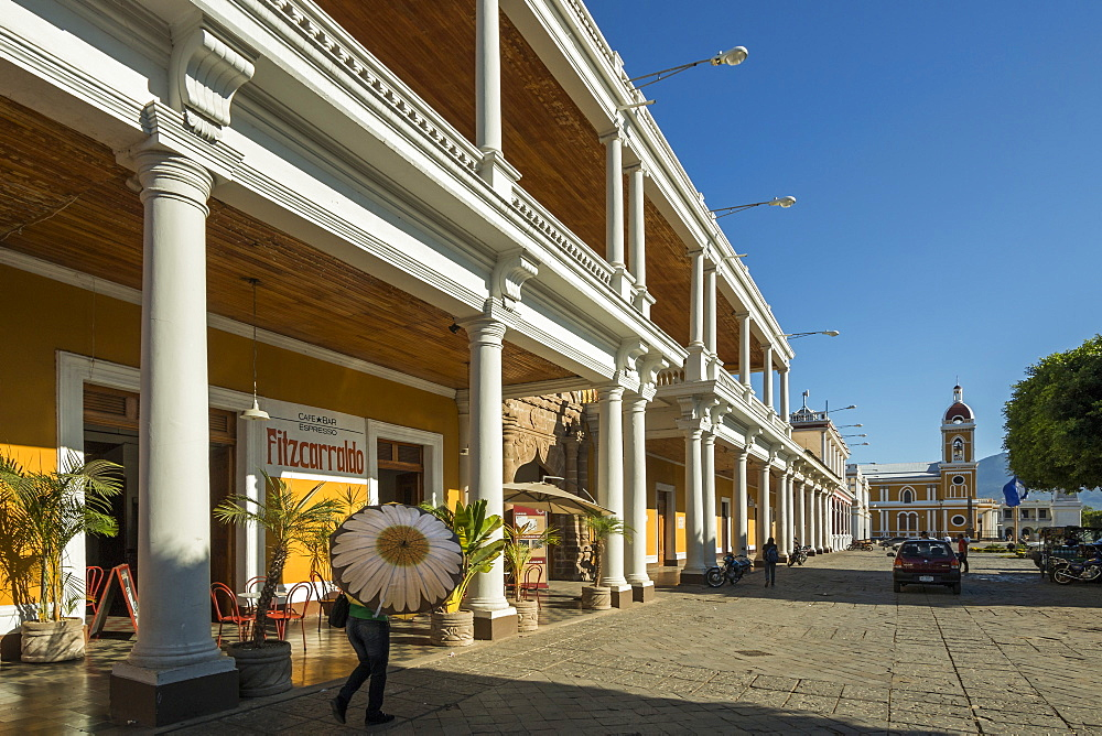 View along colonnades of Plaza de la Independencia to Granada Cathedral in the heart of this historic city, Granada, Nicaragua, Central America