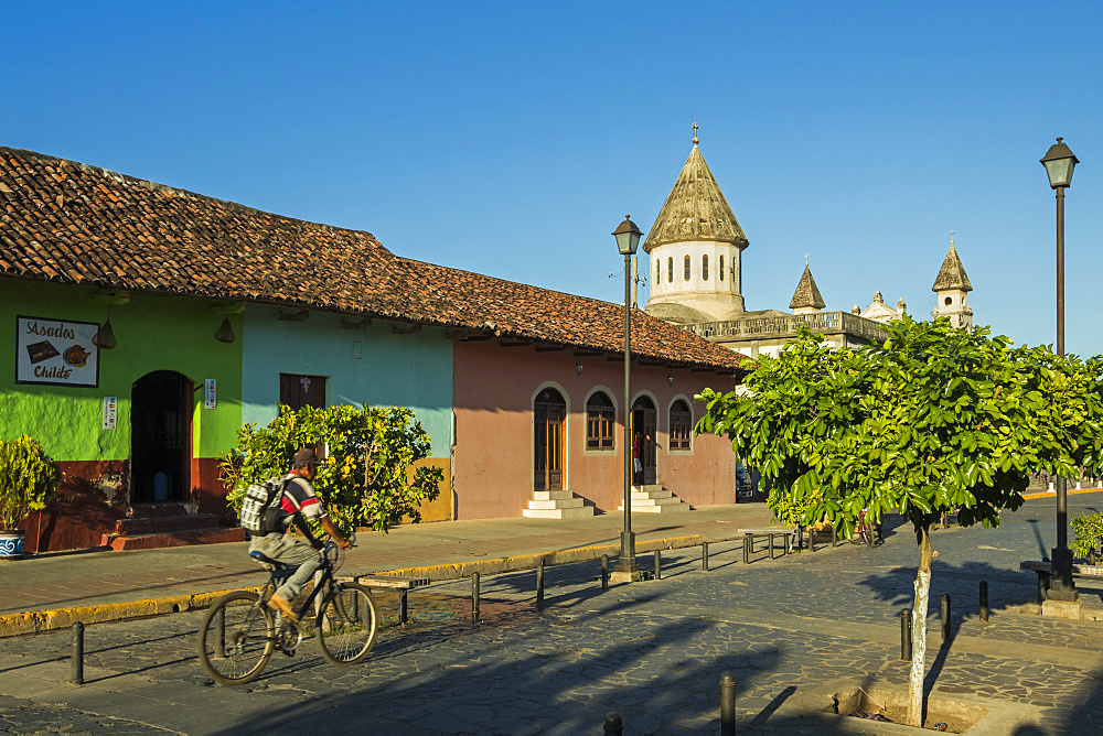 Colourful buildings and Church of Guadelupe on popular Calle de la Calazada in centre of this historic city, Granada, Nicaragua, Central America