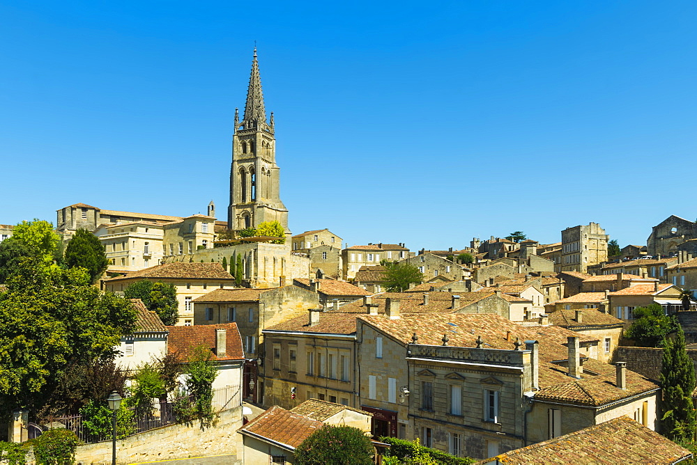 The 53 metre bell tower of the 13th century church in this historic town and famous Bordeaux red wine region, Saint Emilion, Gironde, France, Europe - 83-12980