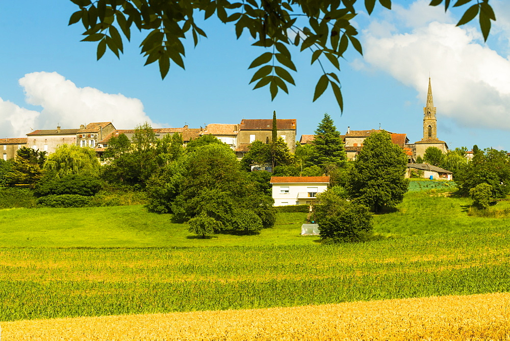 View over fields in summer towards this quiet hilltop village near Duras. Lévignac-de-Guyenne; Lot-et-Garonne; Aquitaine; France